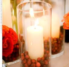 candle, cranberries, deep red roses - theknot.com