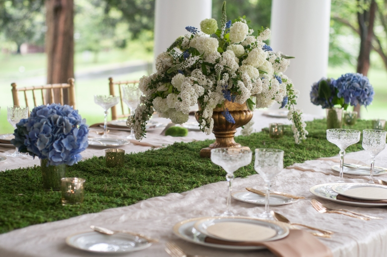 This is one of my favorite table designs and it shows that you don't have to do something bold to obtain that wow-factor.  The combination of moss with white and blue hydrangea and the gold details is elegant and stunning. Photo Credit: Evelyn Alas Photography and B Floral Event Design