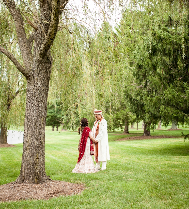 I loved working with Kathlynn and Nishan to plan their Hindu-Christian wedding last Fall at The Bolger Center in Potomac, MD.   Kathlynn's favorite spot was by this weeping willow tree and where they had their first look! Photo Credit: Kate Fine Art Photography