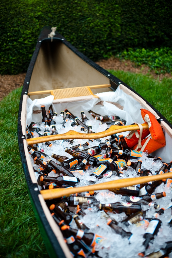 Julie and Adam wanted to incorporate their love of canoeing and the outdoors into their wedding.  This canoe filled with ice and beer was a great idea, in addition to a full bar during their cocktail hour.  Photo Credit: Modern Life Portraits