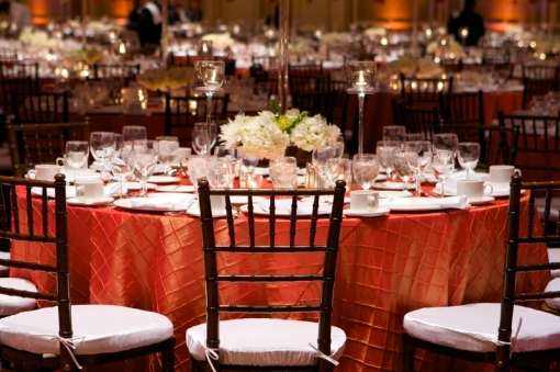 A pintuck linen is very classic for weddings, try a bold color a look that is fresh and modern. http://www.theweddingspecialists.net/fall-wedding-tables.html