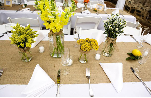 A burlap runner is a great idea to add some interest for wedding tables and can also be done as a DIY project.  http://ruffledblog.com/burlap-and-vintage-tablescapes/