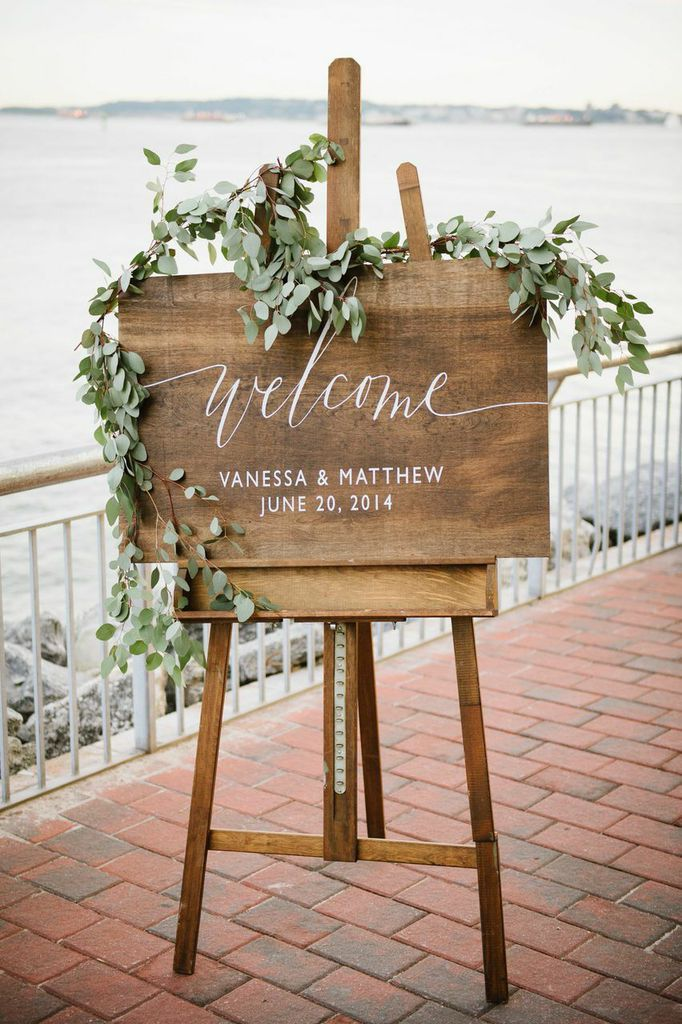 Wood Sign Via ModWedding - Photo by Brian Hatton Photography